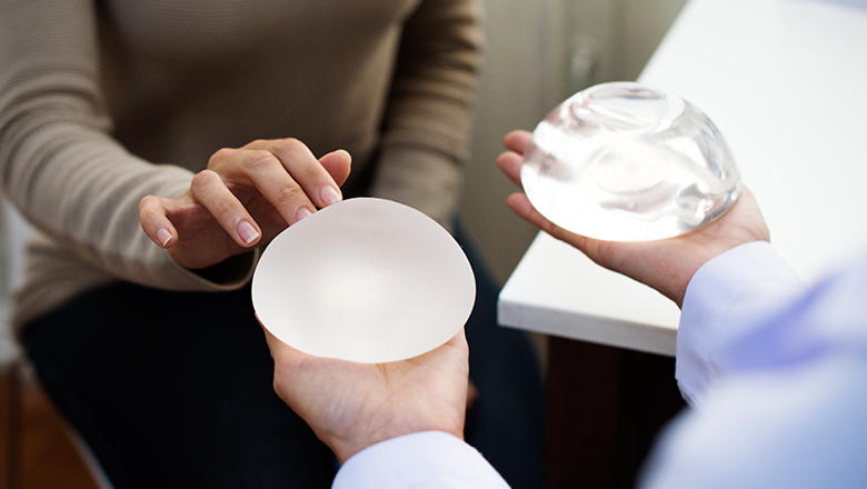 woman selecting breast implants