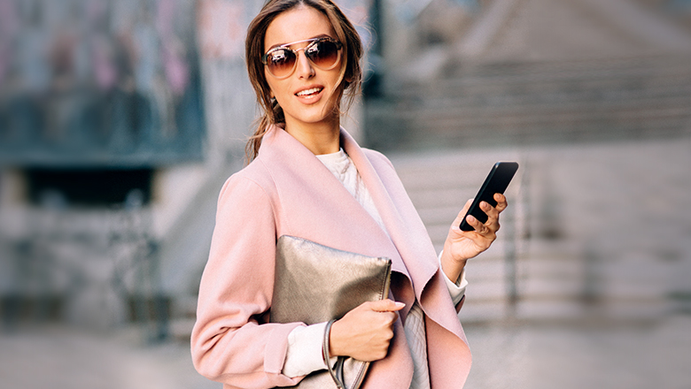 woman using app on her phone