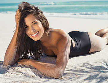 smiling woman on beach in summer