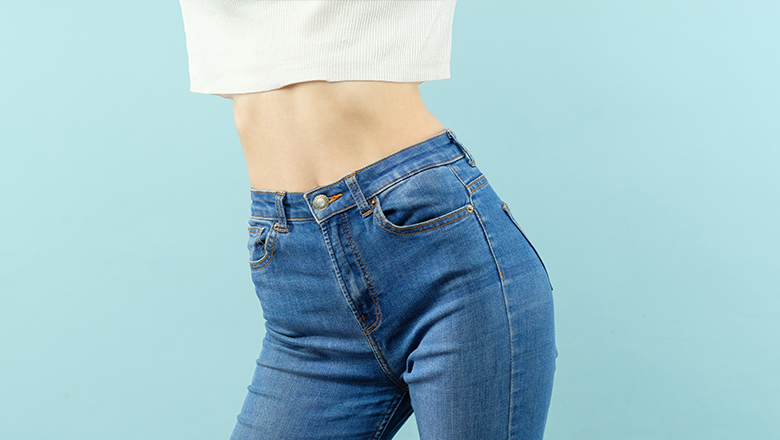 photo of a woman with flat tummy wearing jeans