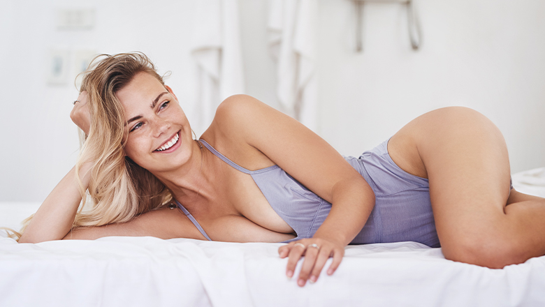 woman lounging in bed in underwear