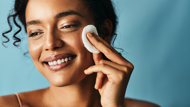 photo of a woman applying skincare